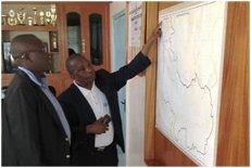 Harim Karugendo, Managing Director of EWASCO, shows the map of the pipeline investment project that will bring water to 75,000 residents of Embu, Kenya.